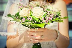 Bride holding her wedding bouquet Royalty Free Stock Image