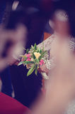 Bride holding her wedding bouquet Royalty Free Stock Photography