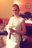 Bride holding her wedding flowers. Beautiful Bride holding her wedding flowers Royalty Free Stock Photography