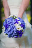 Bride holding lilac wedding bouquet Stock Image