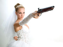 Bride holding the old gun Stock Images