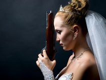 Bride holding old gun Stock Images