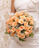 Bride holding orange bouquet detail Royalty Free Stock Photo