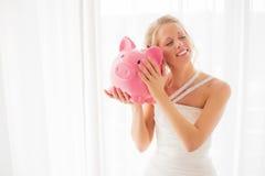 Bride holding a piggy bank Stock Photos