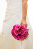 Bride holding pink bouquet Royalty Free Stock Photo