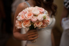 Bride holding pink roses bouquet closeup Stock Images