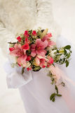 The bride holding pink wedding bouquet Stock Images