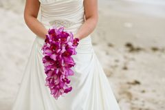 Bride holding purple orchid flower wedding bouquet Royalty Free Stock Photo
