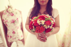 Bride holding red bouquet Stock Photos