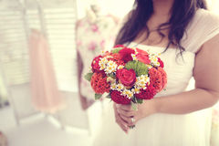 Bride holding red bouquet Royalty Free Stock Photos
