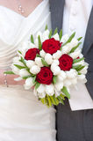 Red rose and white tulip wedding bouquet. Bride holding red rose and white tulip wedding bouquet Stock Image