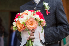 Bride holding red roses bouquet Royalty Free Stock Photography