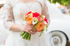 Bride holding red roses bouquet Stock Image
