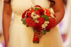 Bride holding red wedding bouquet Stock Photo