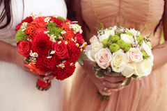 Bride holding red wedding bouquet Royalty Free Stock Photos