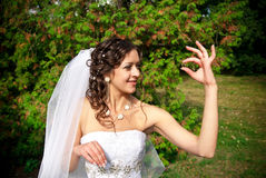 Bride holding ring Stock Photos