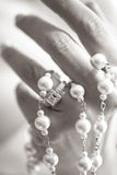 Bride holding a rosary with a ring Royalty Free Stock Photography