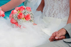 Bride holding roses wedding bouquet Royalty Free Stock Photo