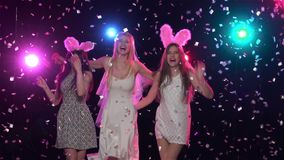 Bride holding gifts with girlfriends bachelorette party. Slow motion. Girls having fun at bachelorette party, bride with gifts hugging her friends, stroboscope stock video