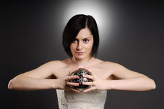 Bride holding a silver ball Royalty Free Stock Photo