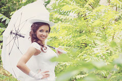 Bride holding umbrella, vintage Stock Photos