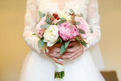 Bride holding beautiful bouquet Royalty Free Stock Images