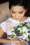 Bride holding unusual wedding bouquet with ranunculus Stock Photo