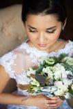 Bride holding unusual wedding bouquet with ranunculus Stock Photo