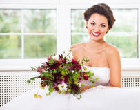 Bride holding unusual wedding bouquet with succulent flowers and Royalty Free Stock Photo