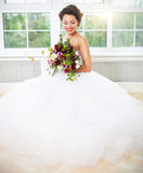 Bride holding unusual wedding bouquet Royalty Free Stock Photography