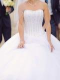 Bride Holding Veil Skirt Stock Photography