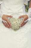 Bride is holding a vintage heart Royalty Free Stock Photo