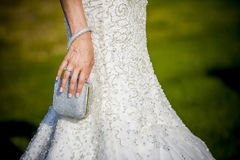 Bride holding wedding bag Stock Photo