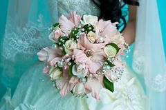 Bride holding a wedding bouquet Royalty Free Stock Photo