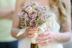 Bride holding a wedding bouquet Royalty Free Stock Photos