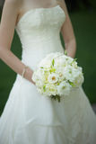 Bride holding wedding bouquet Royalty Free Stock Photography