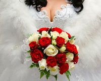 The bride holding a wedding bouquet.  Royalty Free Stock Images