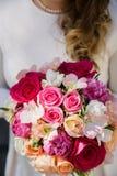 The bride holding a wedding bouquet.  Stock Photos