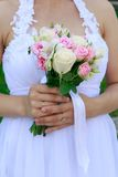 Bride holding wedding bouquet. Bride is holding beautiful bright wedding bouquet Stock Photos