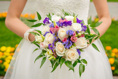 Bride holding wedding bouquet. Bride is holding beautiful bright wedding bouquet Stock Images