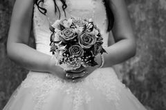 Bride holding a wedding bouquet Royalty Free Stock Images