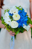 Bride holding a wedding bouquet of blue hydrangea flowers Royalty Free Stock Photography