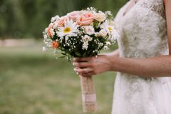 Bride holding the wedding bouquet royalty free stock photo
