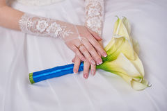 Bride is holding a wedding bouquet of callas Stock Images