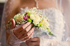 Bride holding wedding bouquet Stock Images