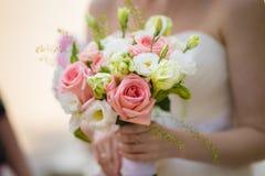 Bride holding wedding bouquet Royalty Free Stock Image