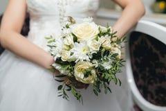 Bride holding wedding bouquet Stock Photography