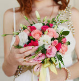 Bride holding wedding bouquet close up Stock Photo