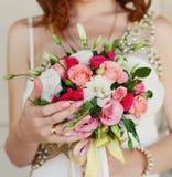 Bride holding wedding bouquet close up Stock Photo