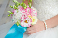 Bride holding wedding bouquet close up Stock Images